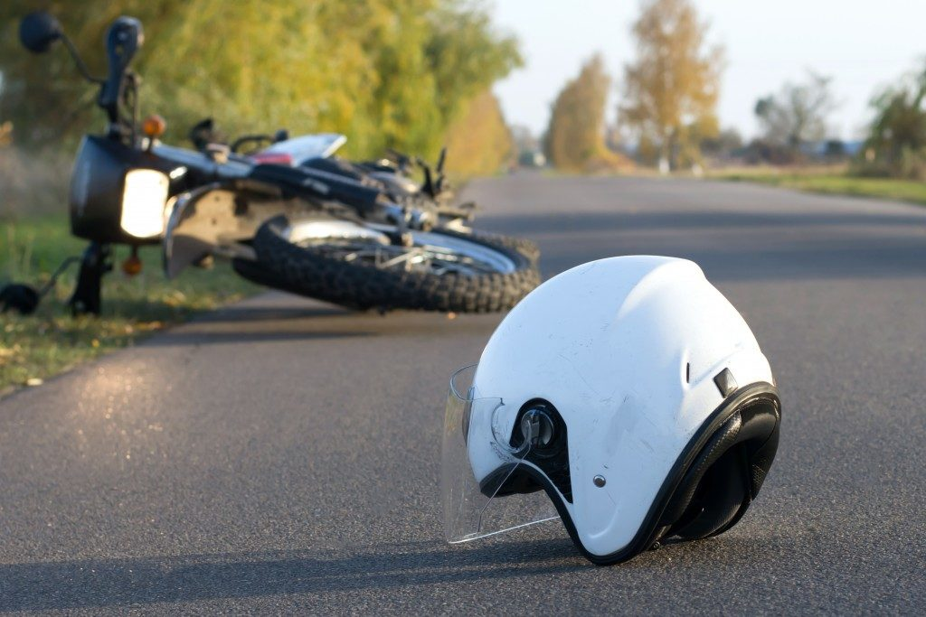 Helment and motorcycle on the road